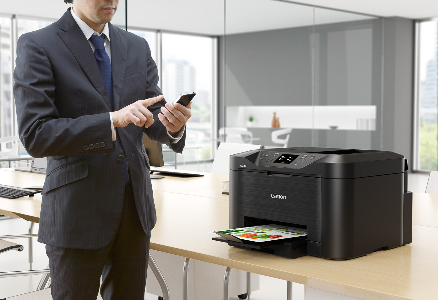 man printing from his phone on a maxify mb5060