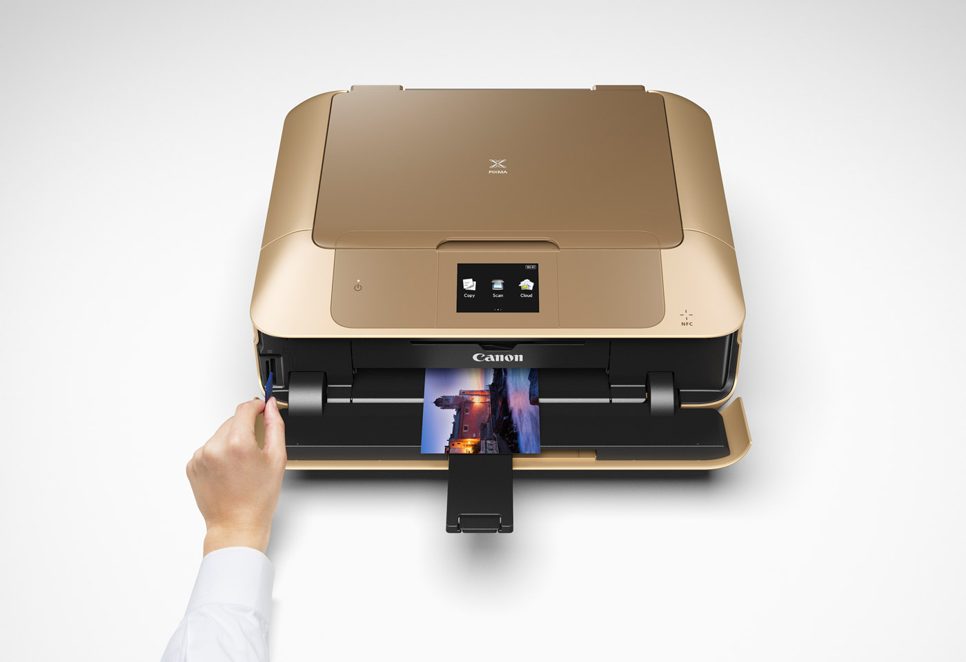 gold printer with hand putting in an SD card