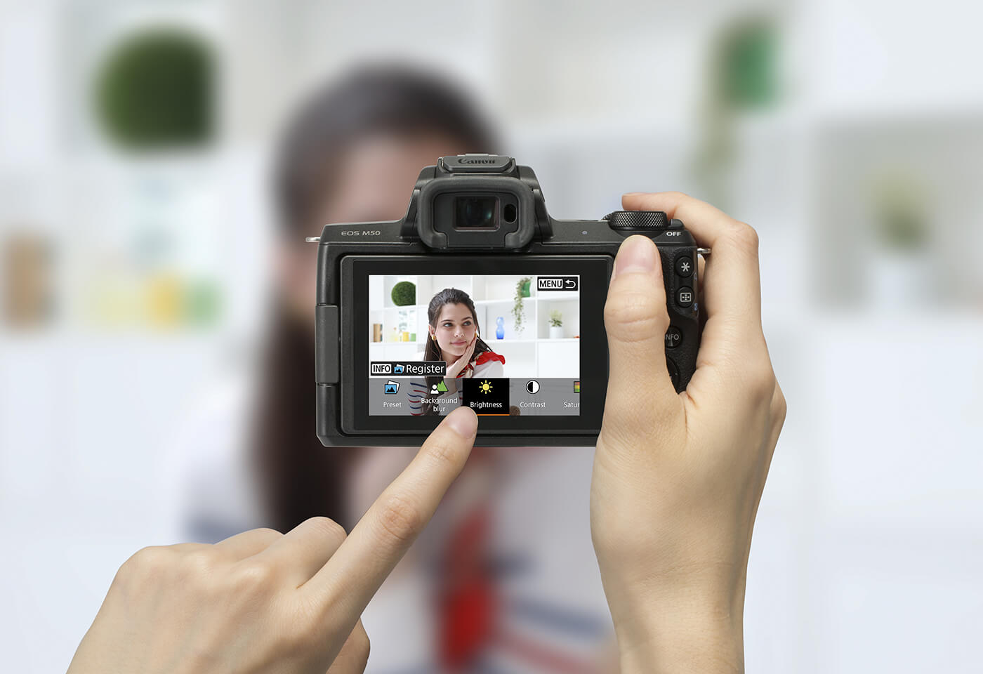 Image of person taking photo taken with an EOS M50