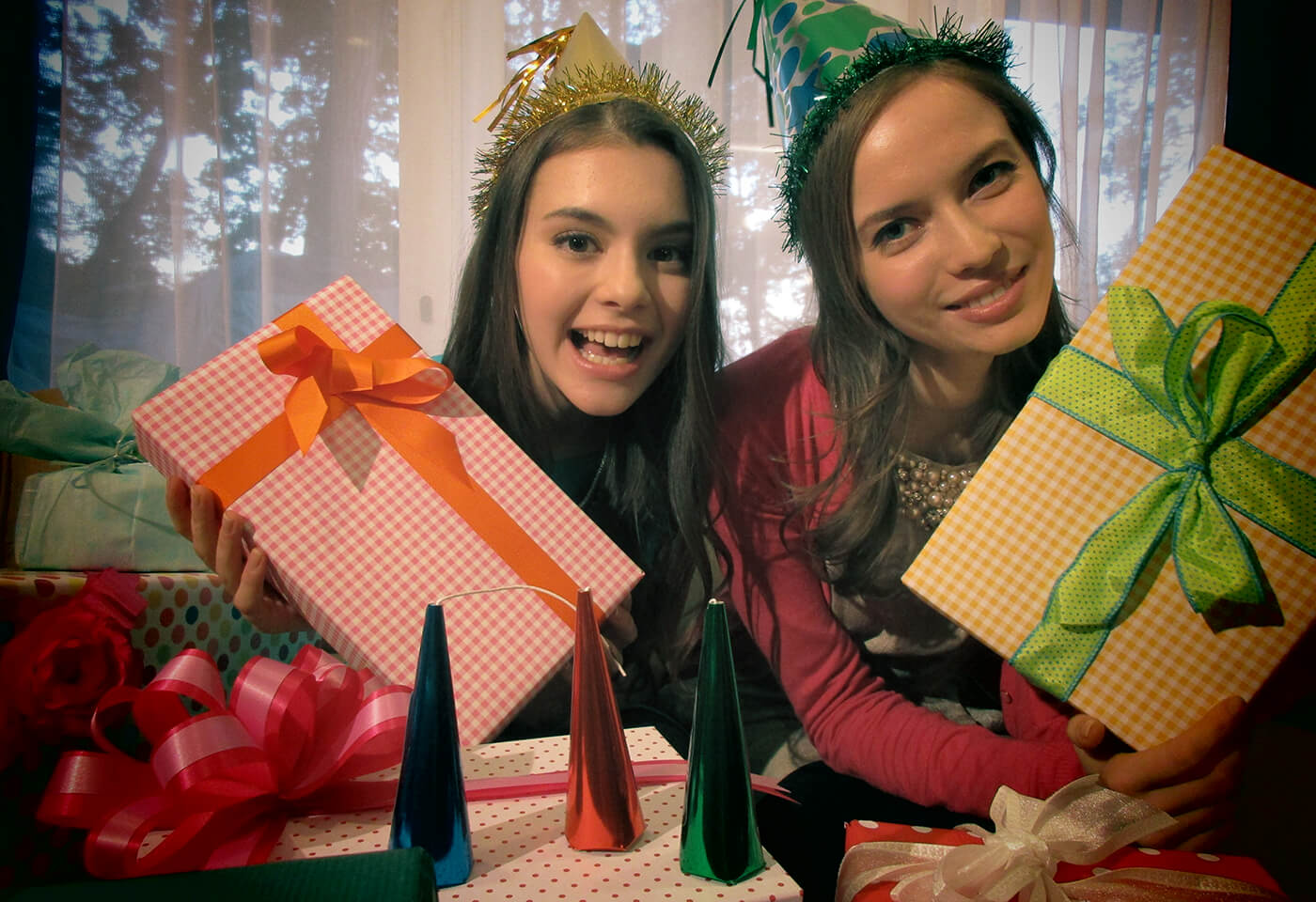 Image of two girls holding wrapped presents
