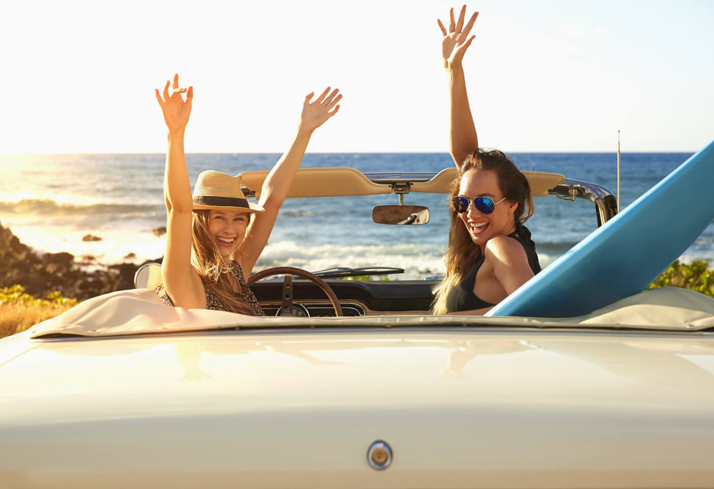 Image of two girls in convertible car