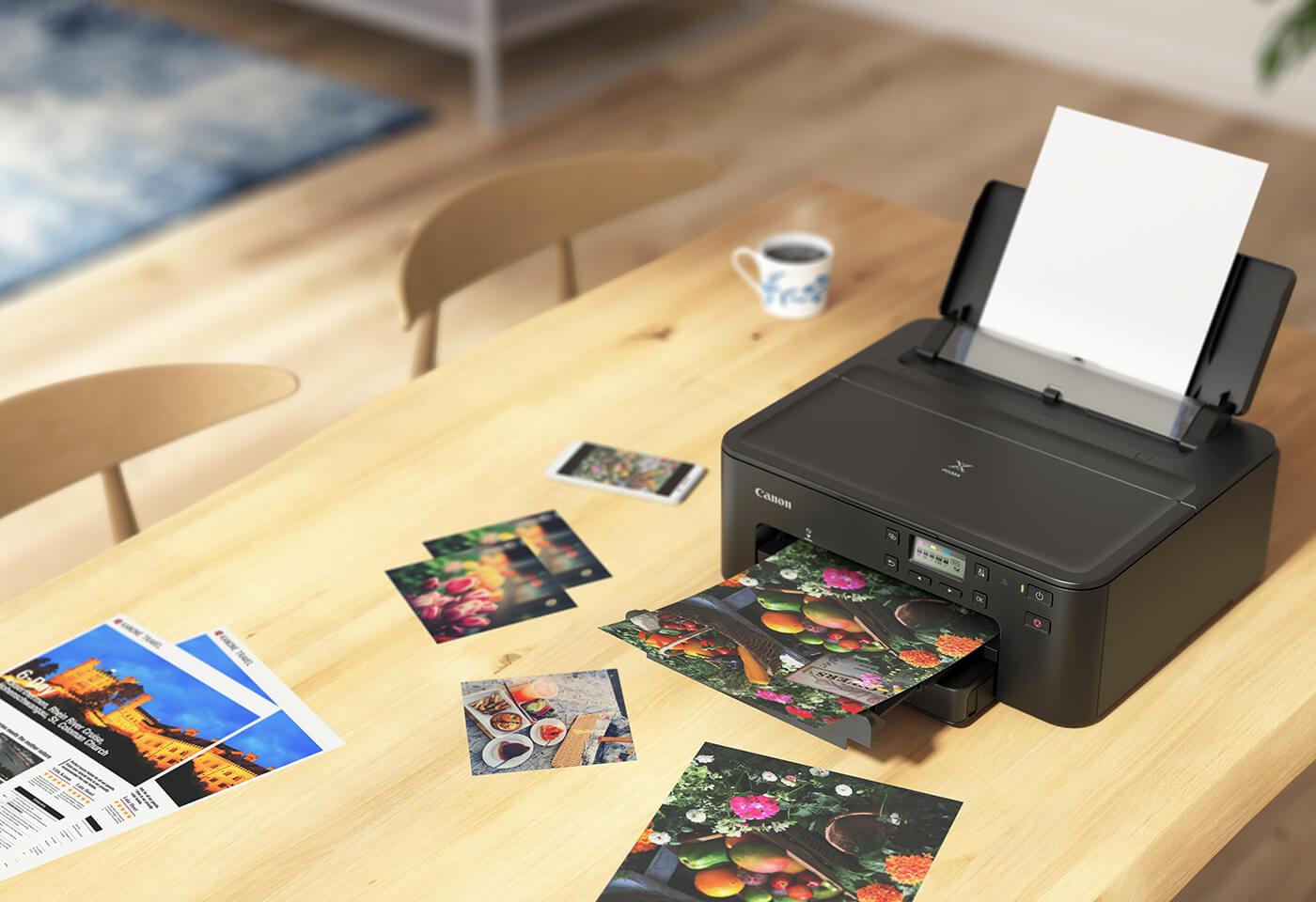 PIXMA TS706 printing vibrant photos on desk