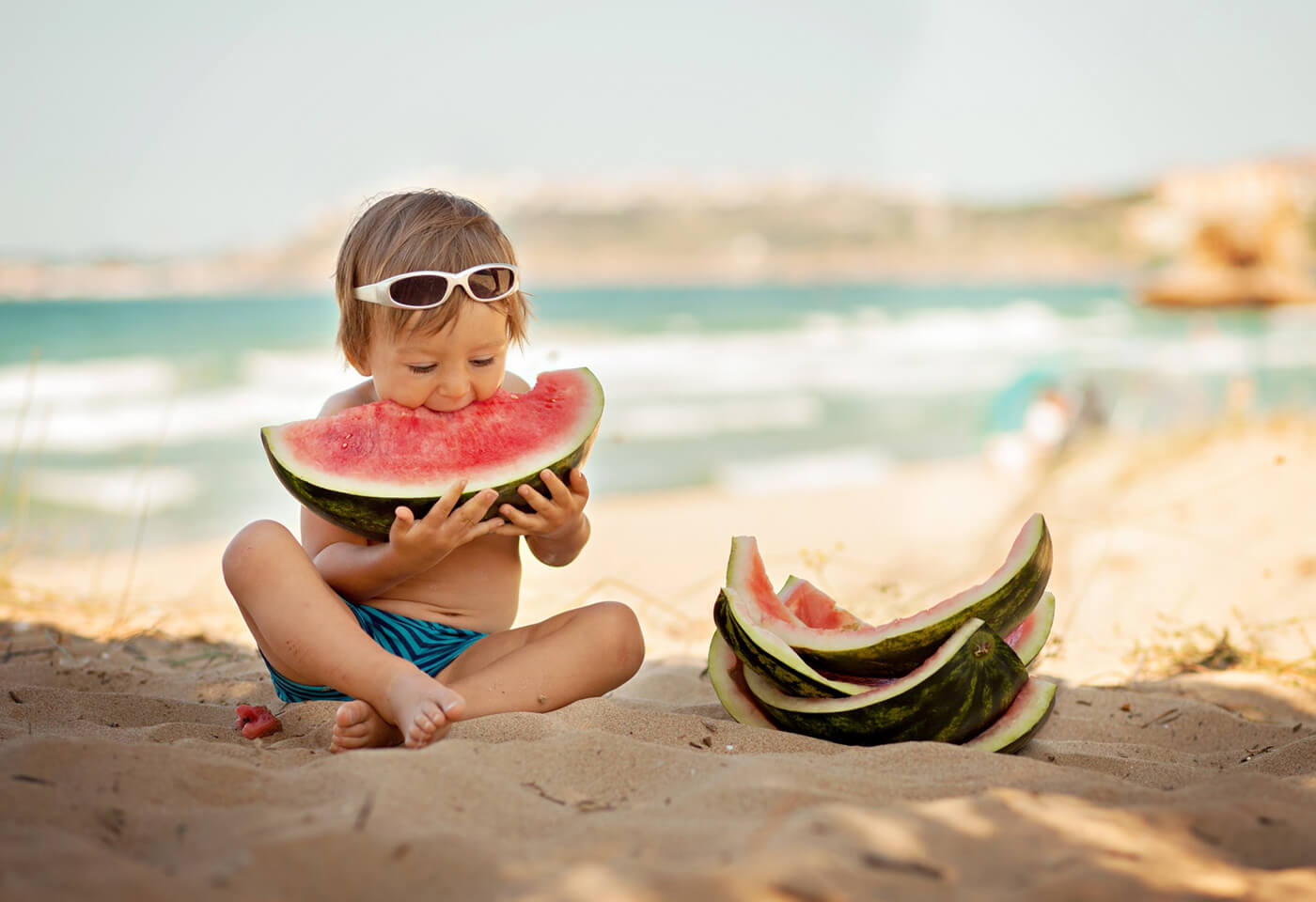 Image of child eating watermelon