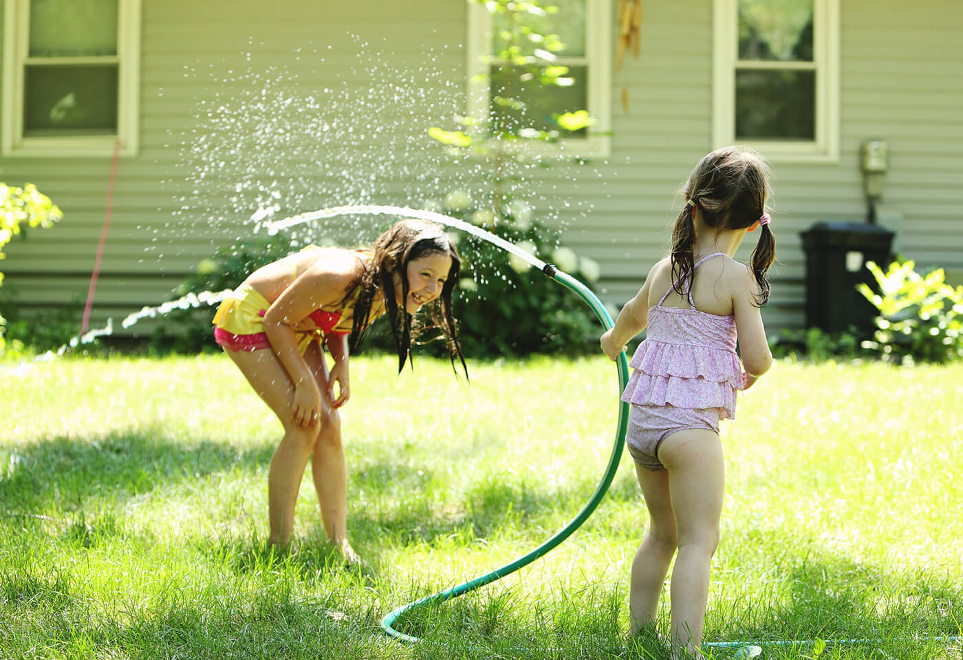 Image of Image of children playing with a water hose