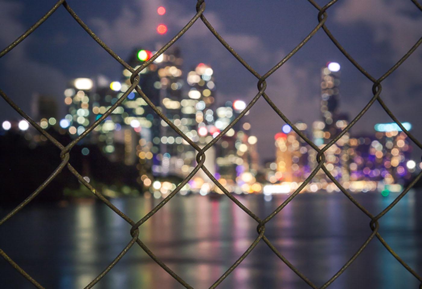 Landscape image of Kangaroo Point through a gate