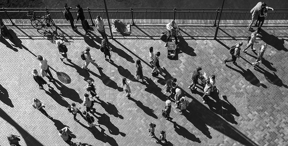 black and white image of a Birds eye view of people