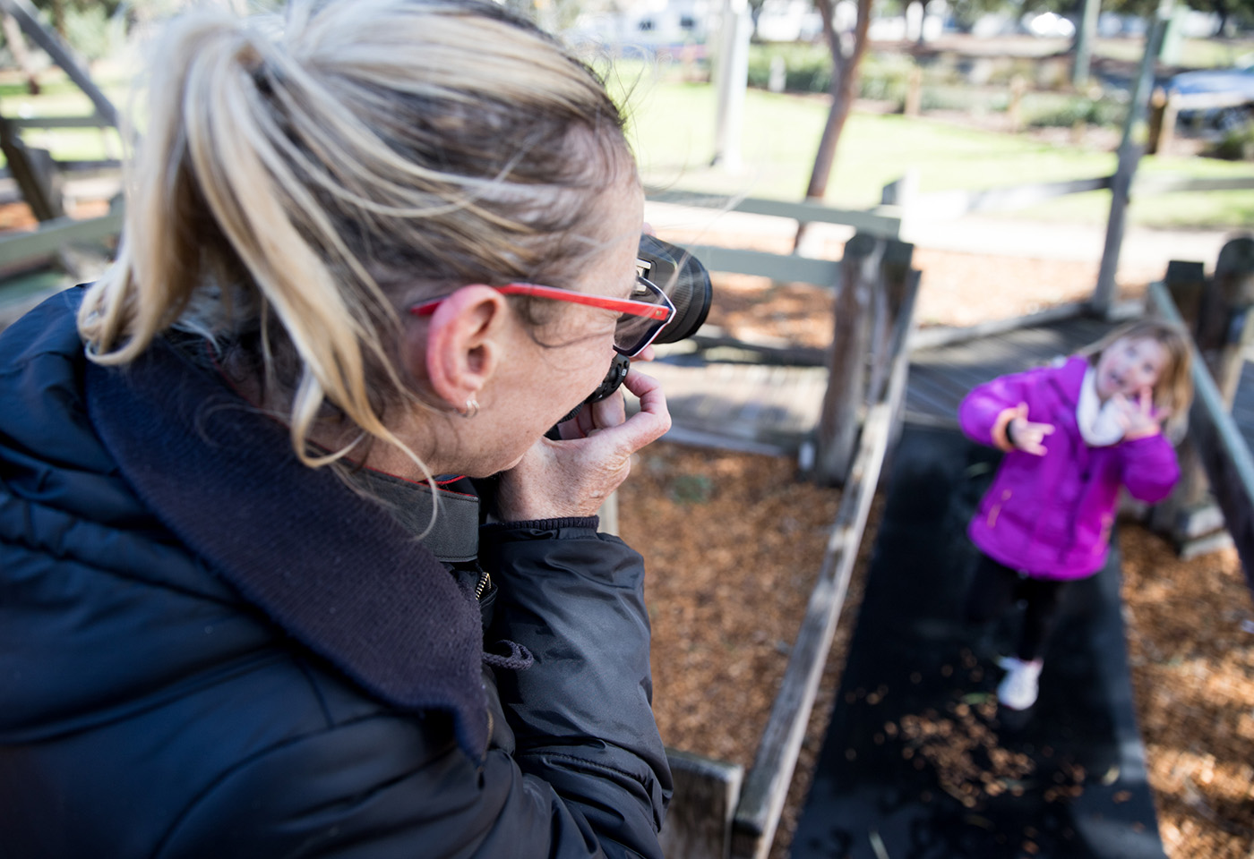 Image of mum taking photo of daughter by Neal Walters