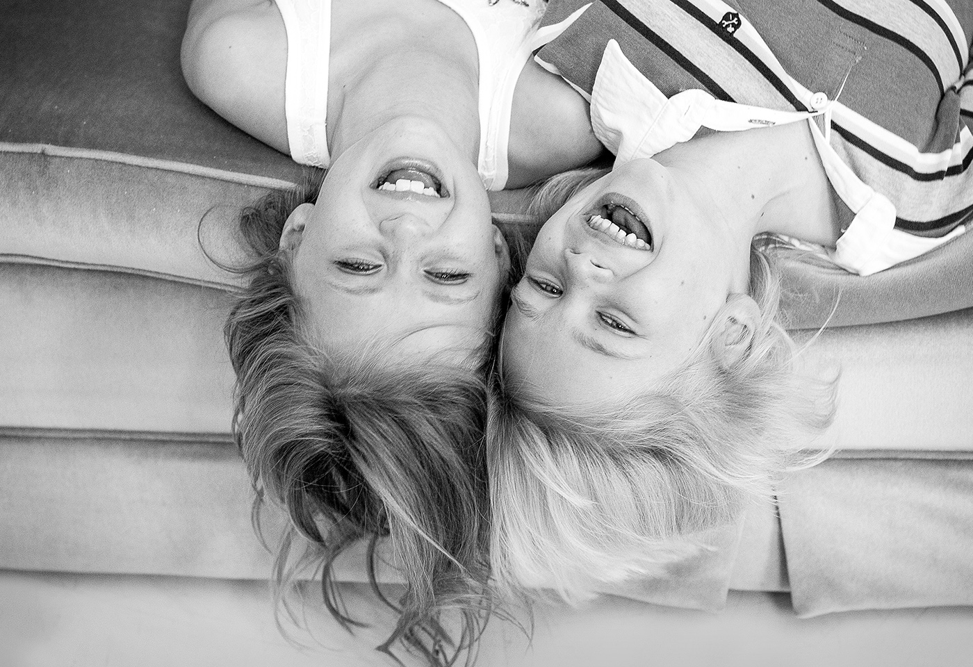 black and white portrait image of two kids upside down by Willow Belle