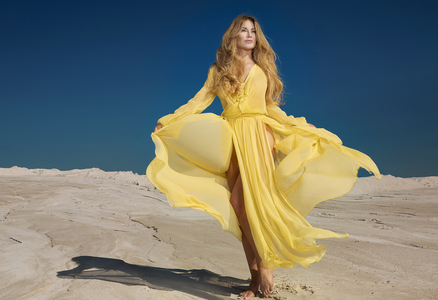 fashion image women yellow dress sand dune