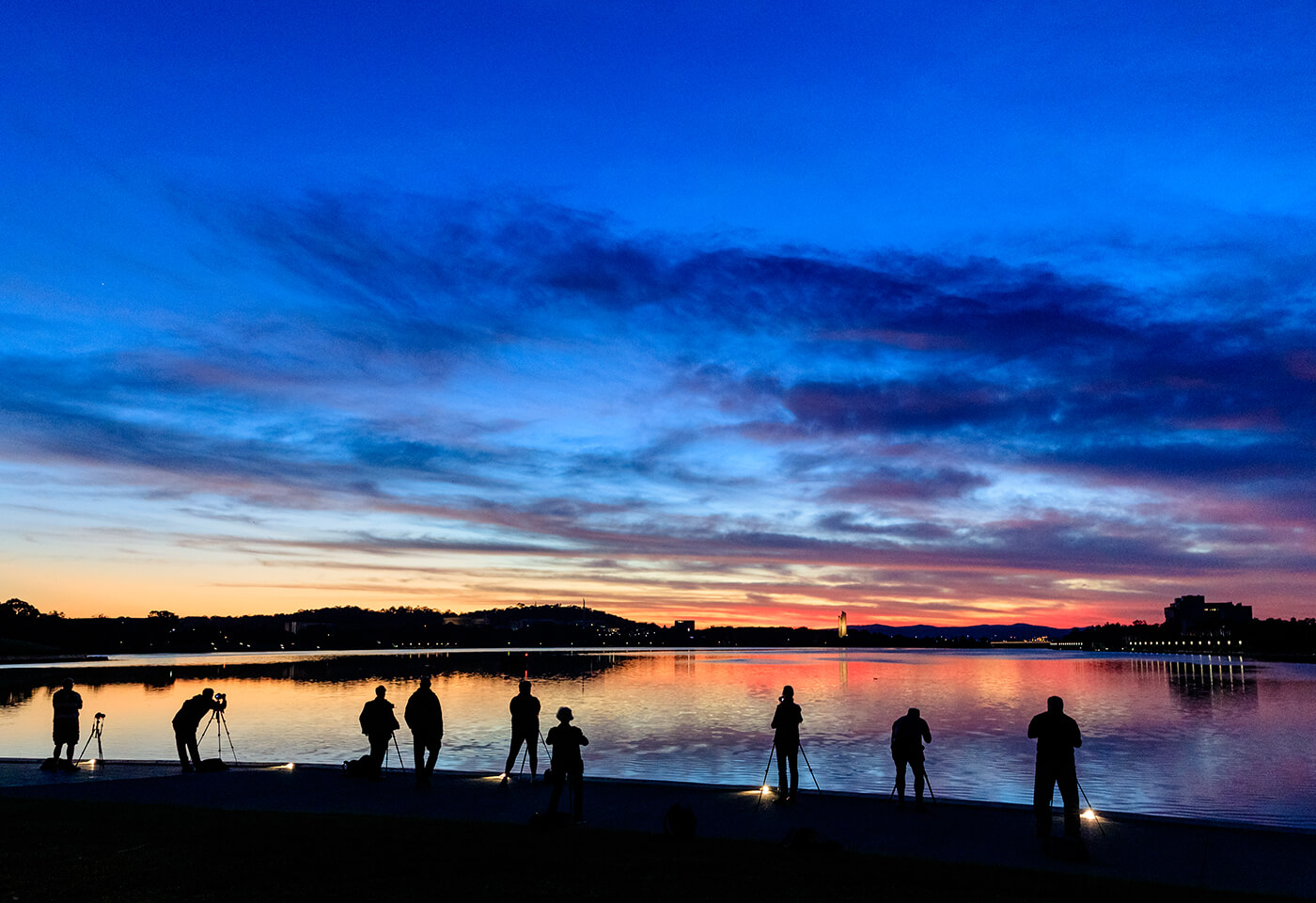 Photographers shooting sunset at Windamere Dam