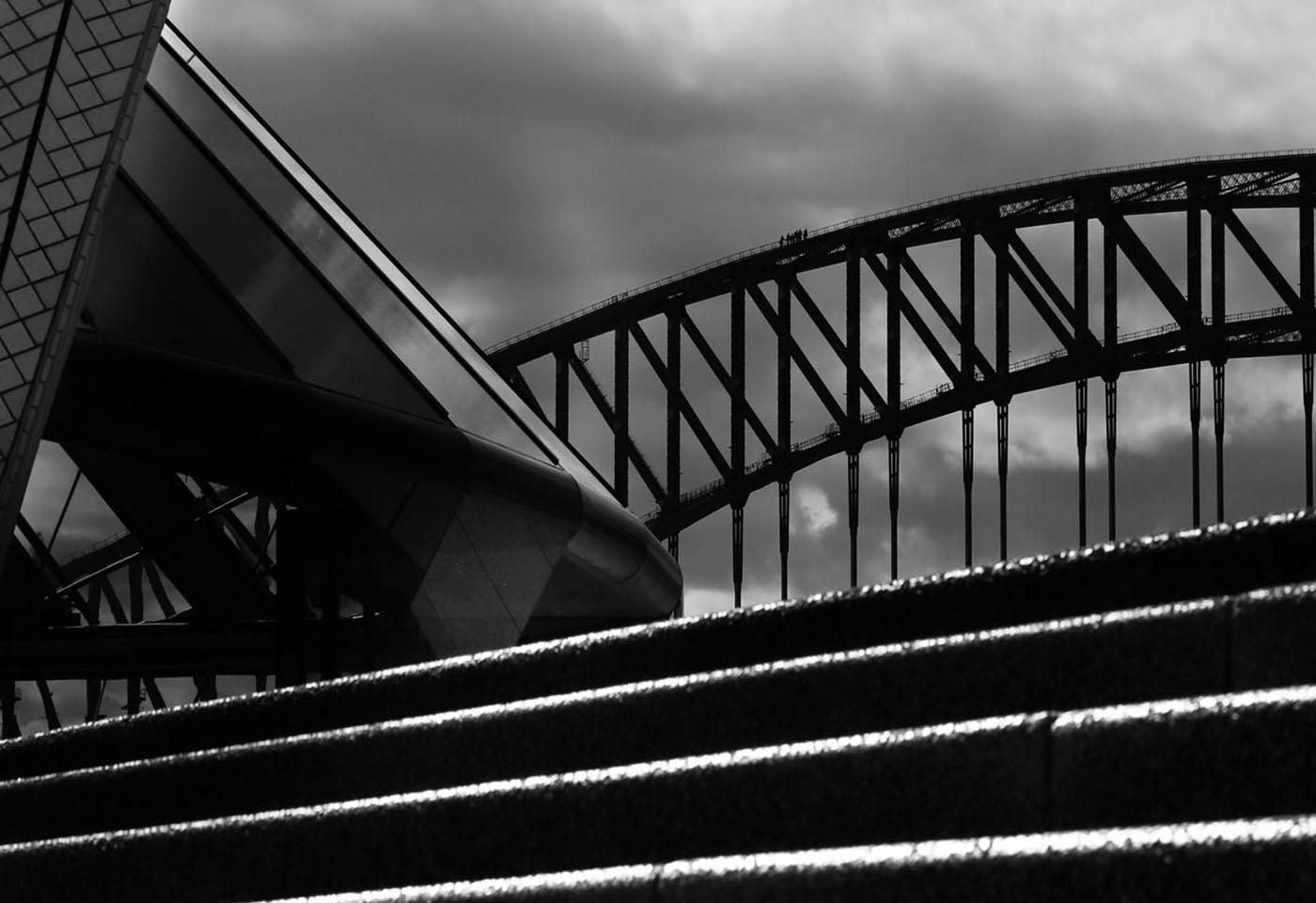 Landscape black and white image of harbour bridge