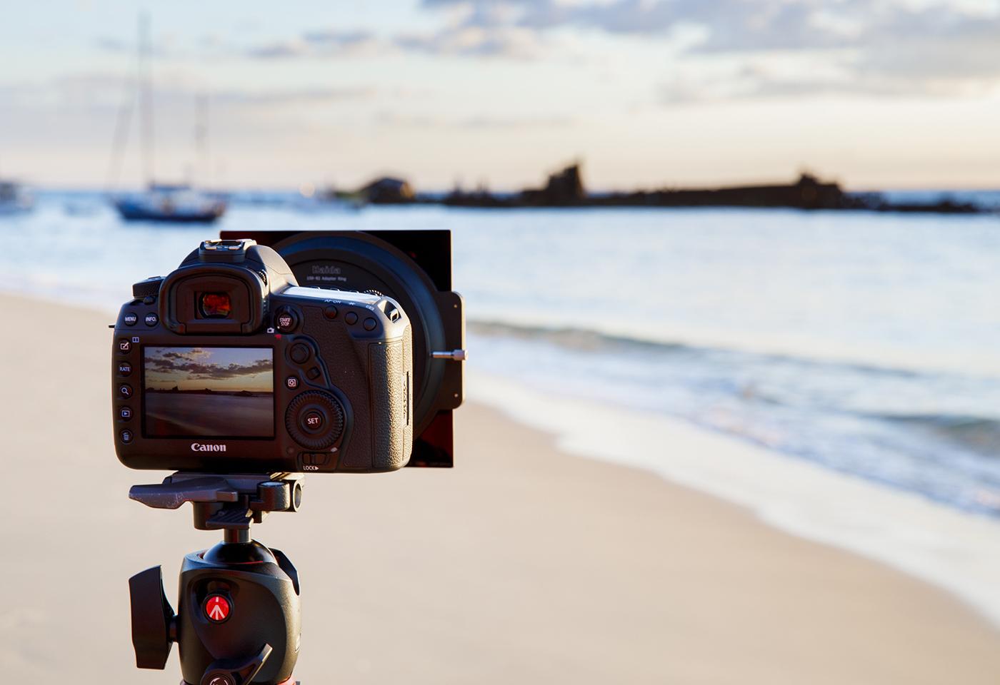 Image of camera on tripod at a beach