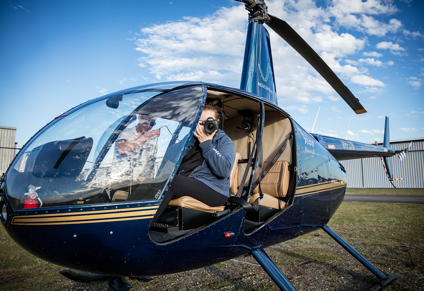 Image of photographer in helicopter