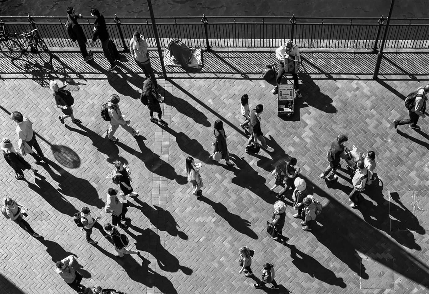 Black and white birds eye view image of pedestrians