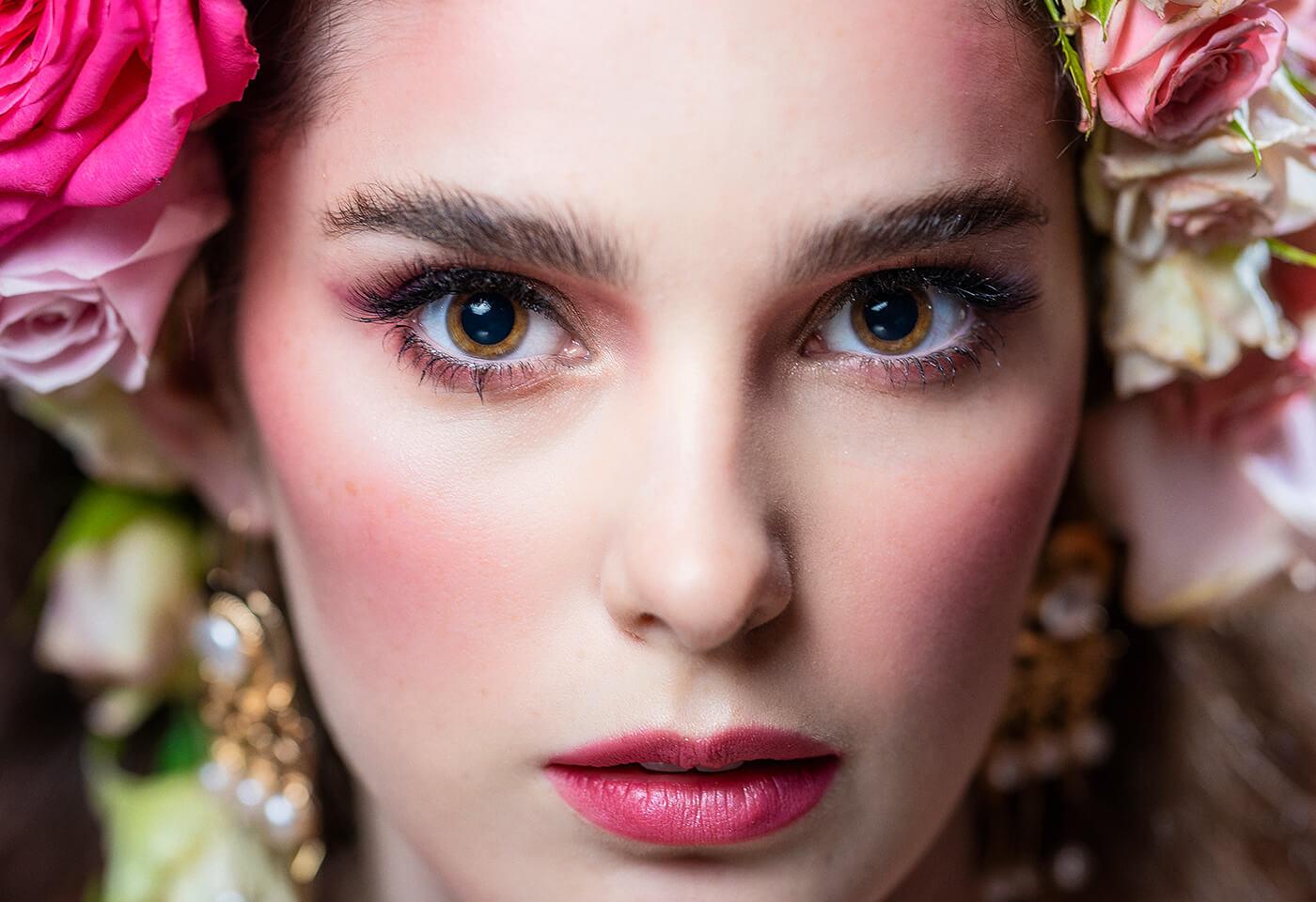 Model doing glamour shot by Greg Sullavan