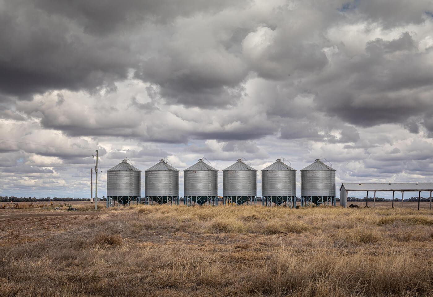 Water tanks in a farm by Greg Sullavan