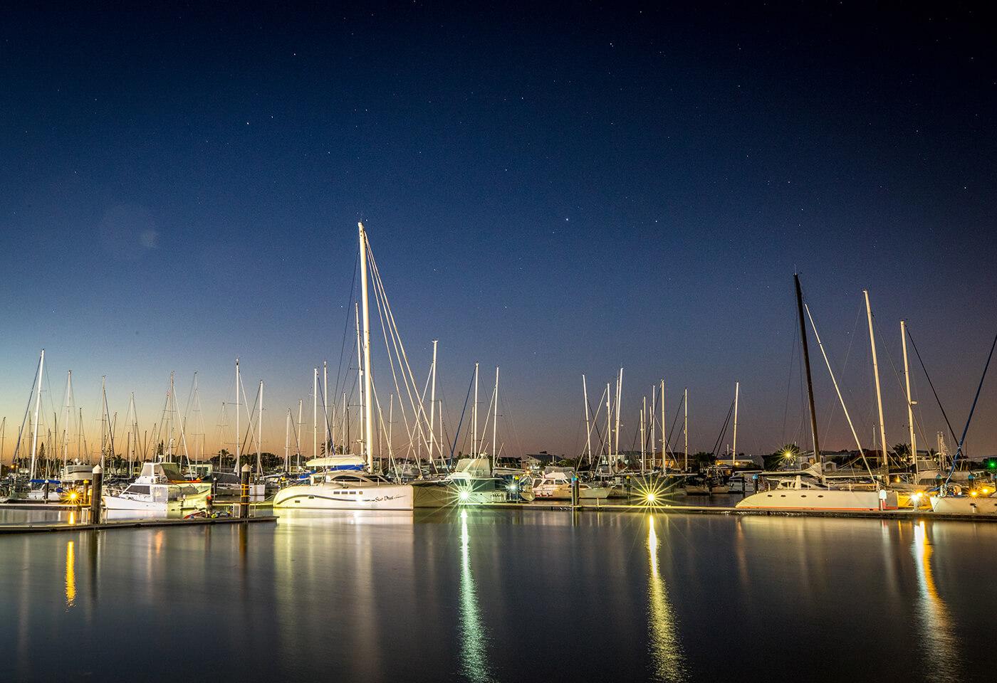 Landscape image of boats on harbour