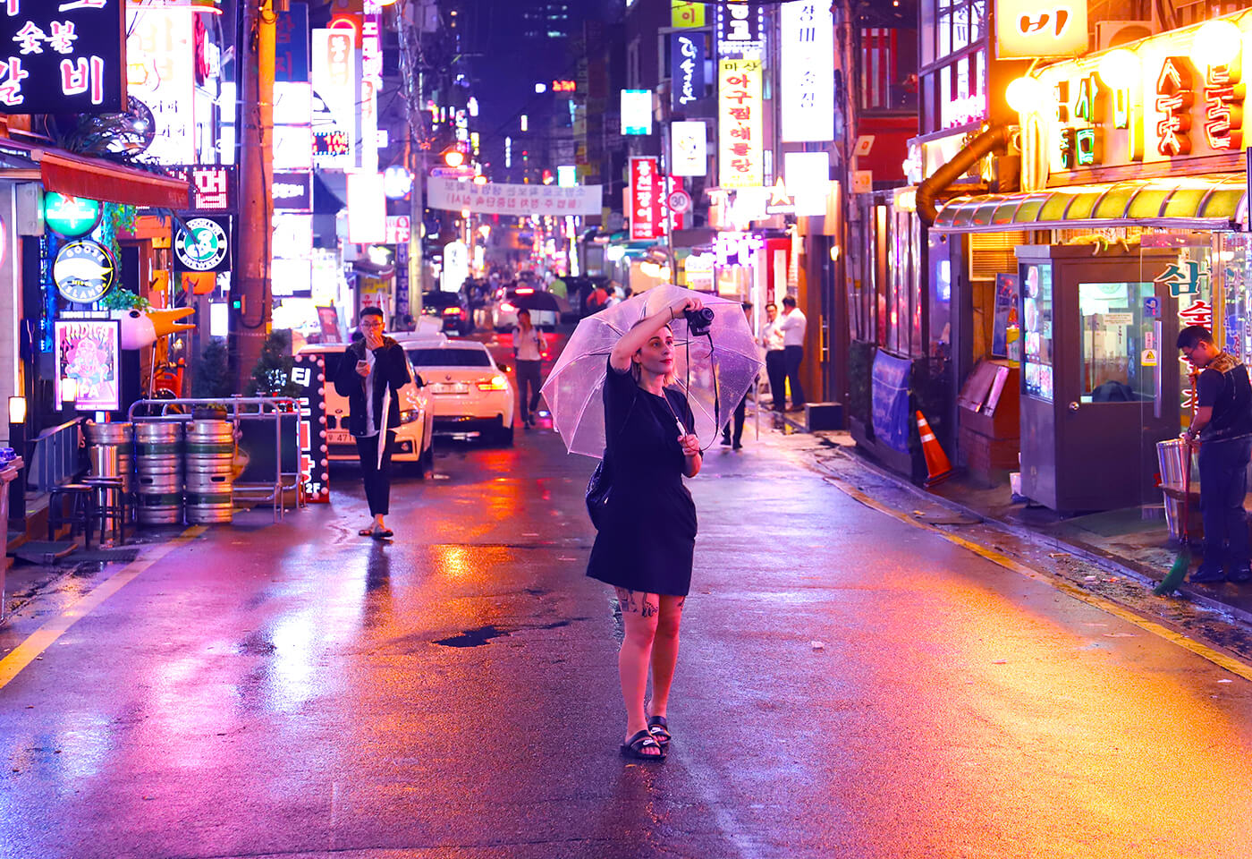 Angela with umbrella on streets of Korea