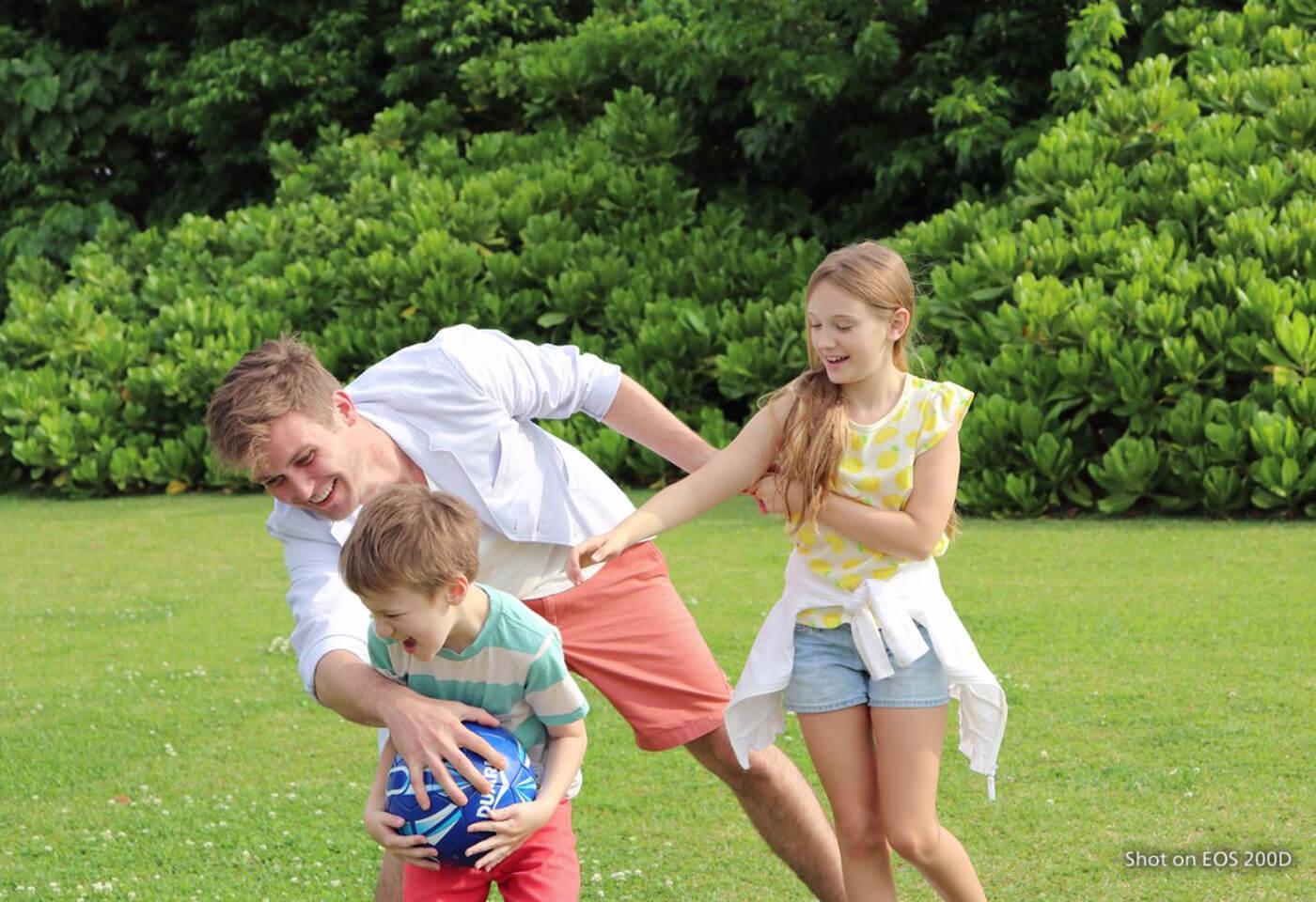 Image of family playing soccer