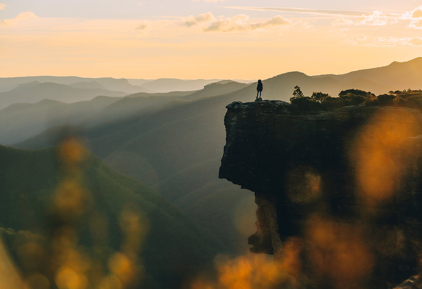 Person on rock cliff edge