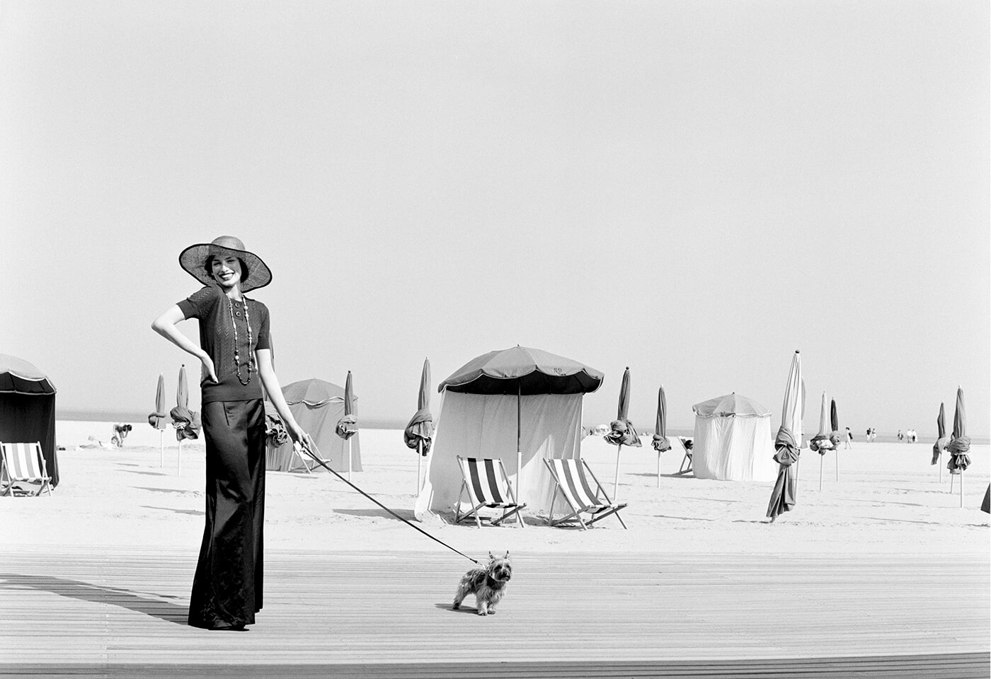 Black and white image of woman walking dog by Graham Shearer