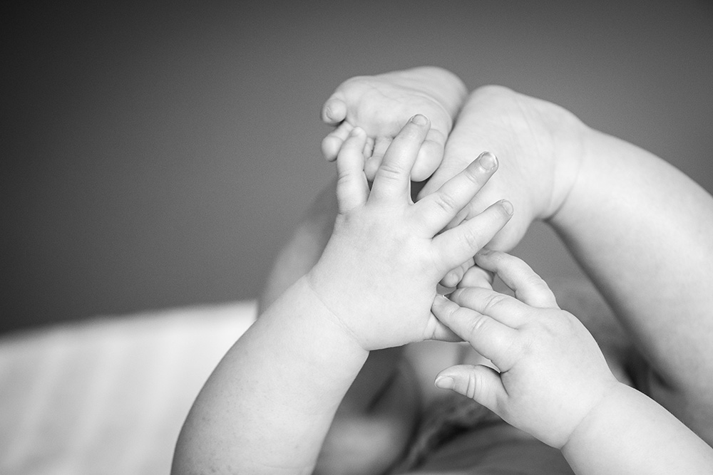 black and white image of baby's feet