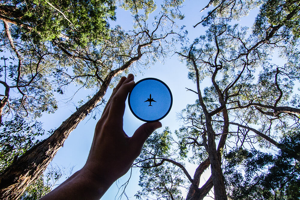 Point of view photograph of toy plane frisbee with sky in background