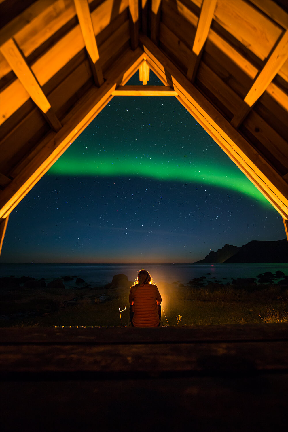 Image of a person under the Northern Lights