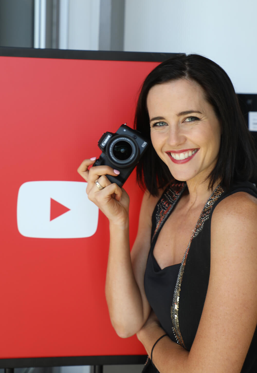 Photo of Vlogger Shae-Lee Shackleford with a Canon EOS M50