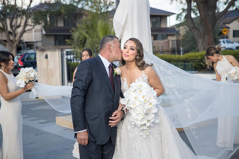 Bride and father outside home photo by Canon Master Ryan Schembri