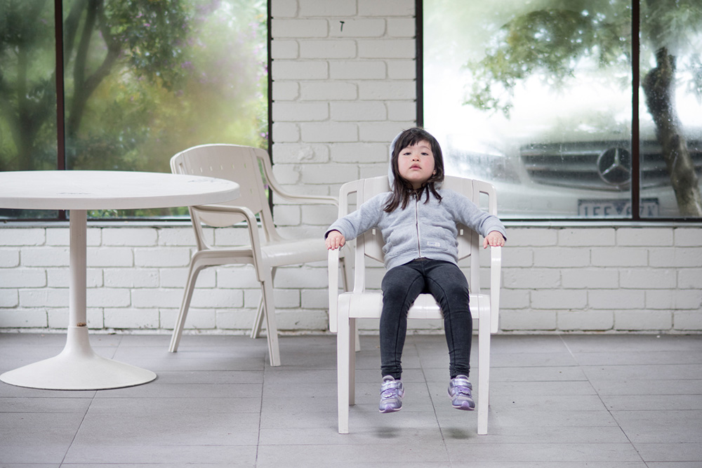 Portrait image of kid in chair