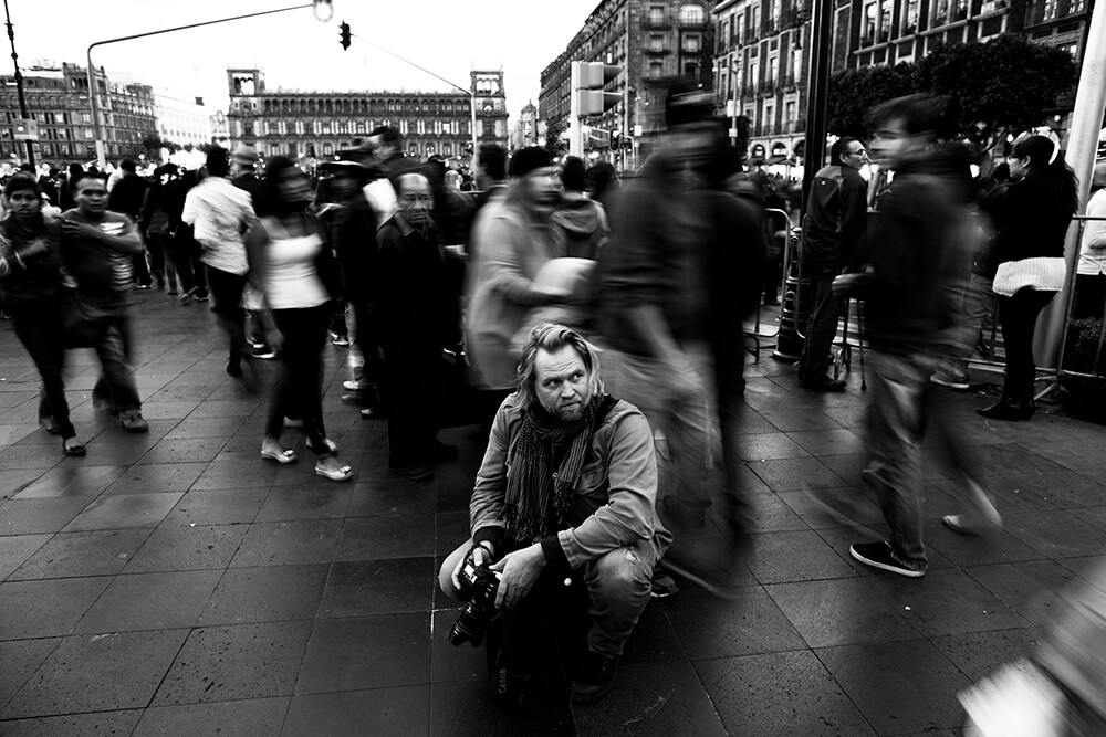Portrait image of photographer crouching
