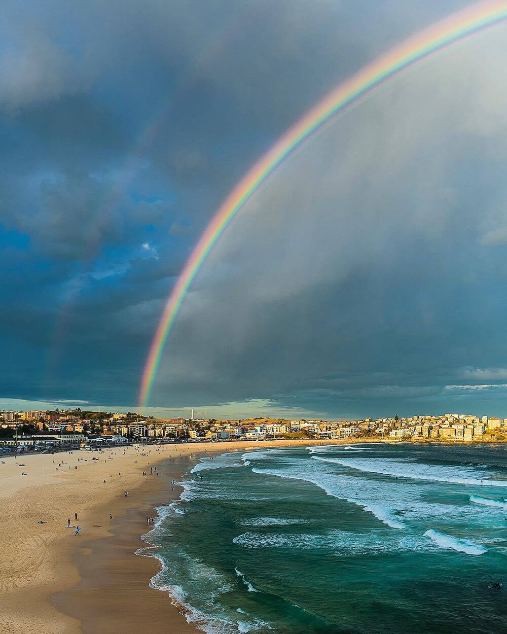 Landscape image of rainbow at beach