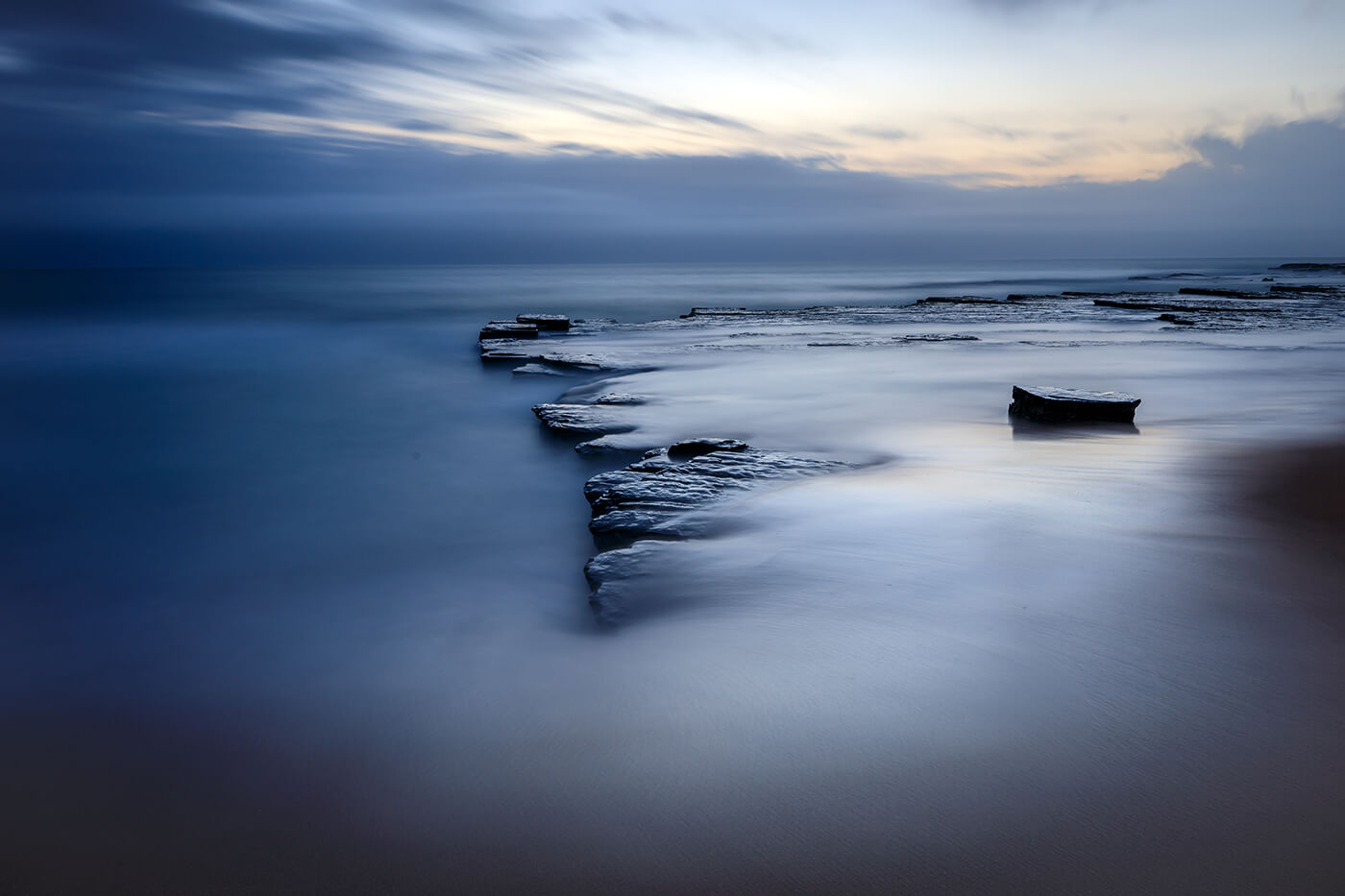Slow shutter image water on rocks by photographer Mike Pearson-Coff