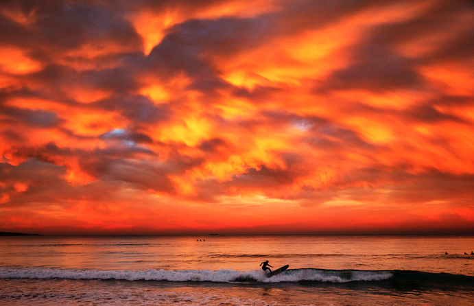 9 surfer at sunset.png