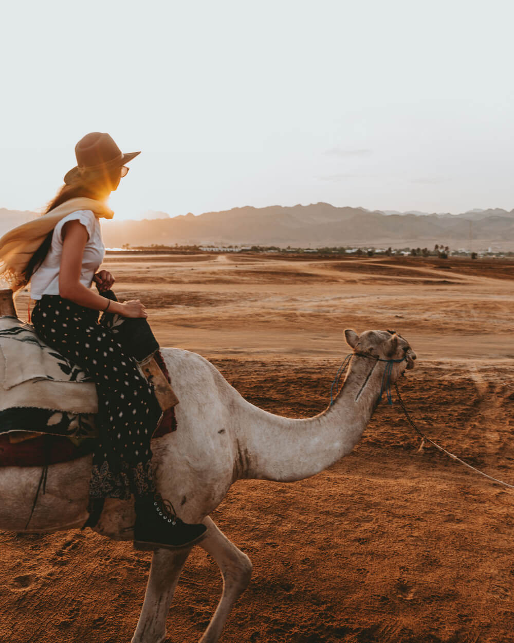 photo of a girl riding a camel. Shot by Jona Grey