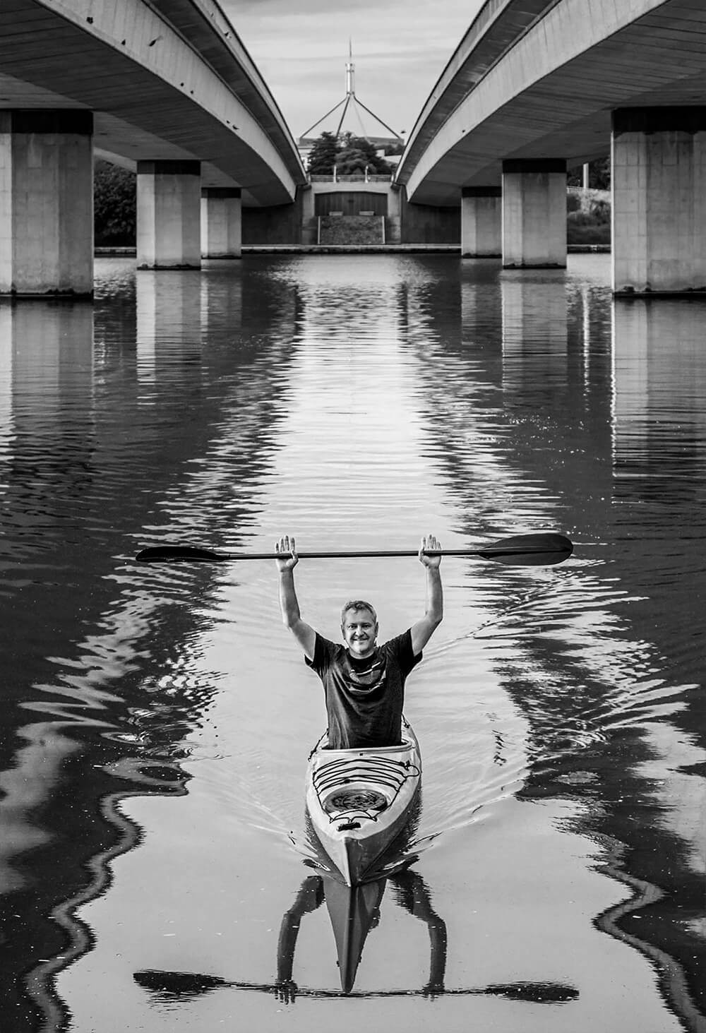 Black and white image of Paul Jurak on kayak
