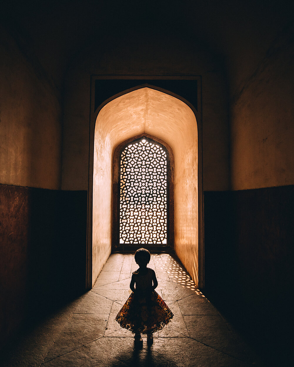 Image of girl in doorway. Shot by Melissa Findley.