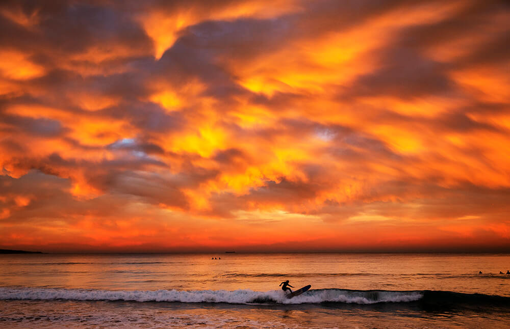 Image of surfer in sunset