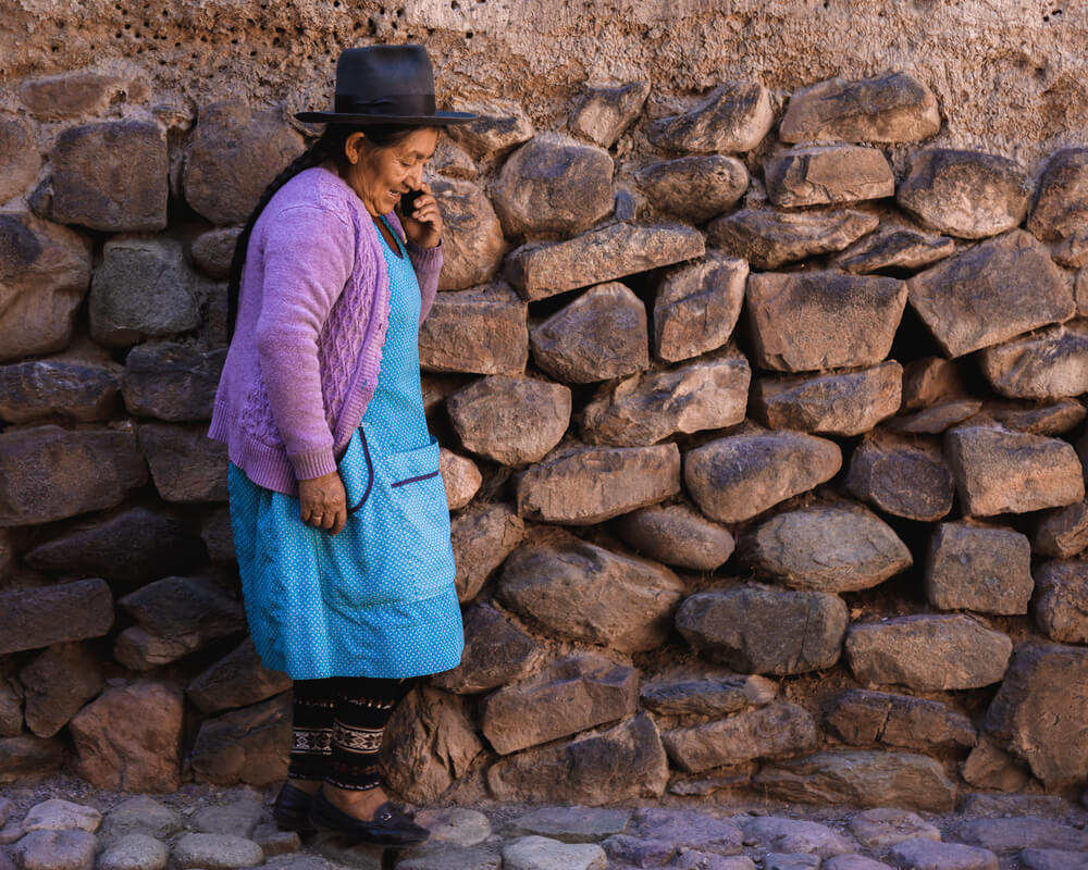 A Peruvian lady walking near the Sacred Valley in Peru. Photo by Jordan Hammond