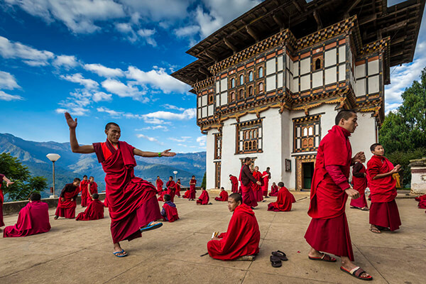 Photo of monks in a temple by Richard Ianson