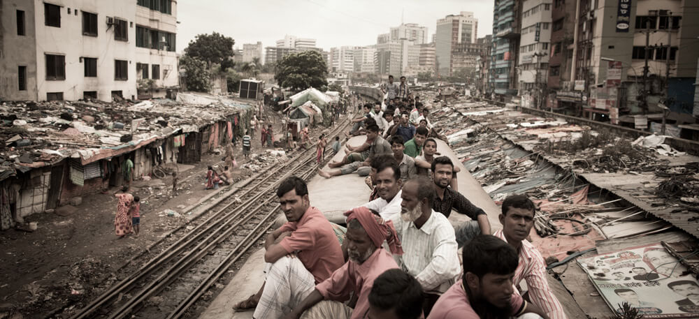 image of Bangladeshi people on the roof of a train