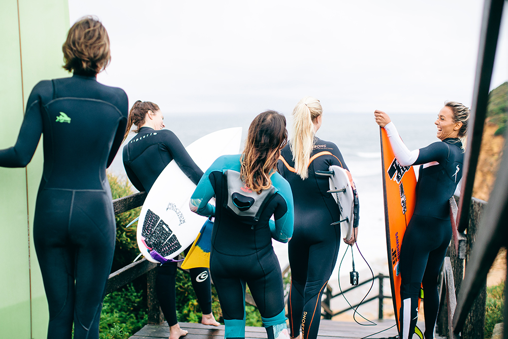 Image of surfers before hitting the waves