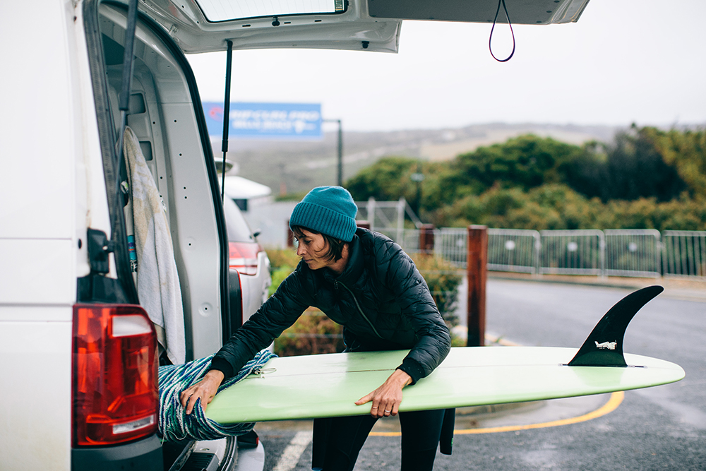 Photo of Belinda Baggs getting ready for a surf at Bells Beach