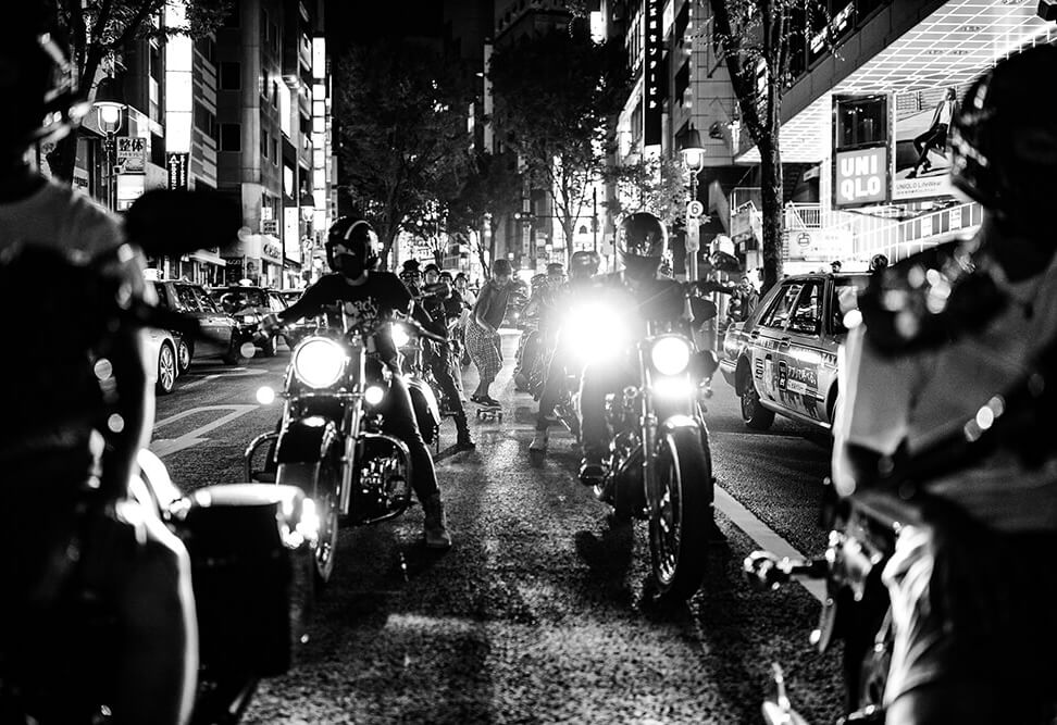 black and white image of motorcyclists in the streets of Tokyo, taken with the EOS R. Photo by Maria Boyadgis