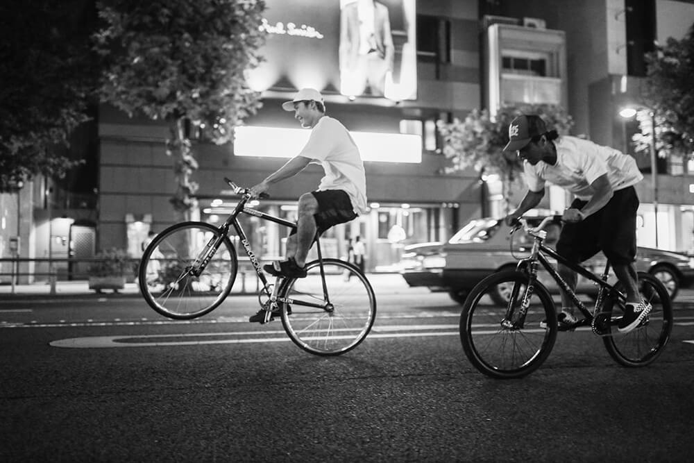 Black and white Image of cyclist taken with the EOS R, by Maria Boyadgis