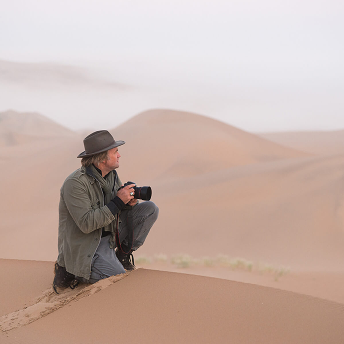 Travel photographer in desert