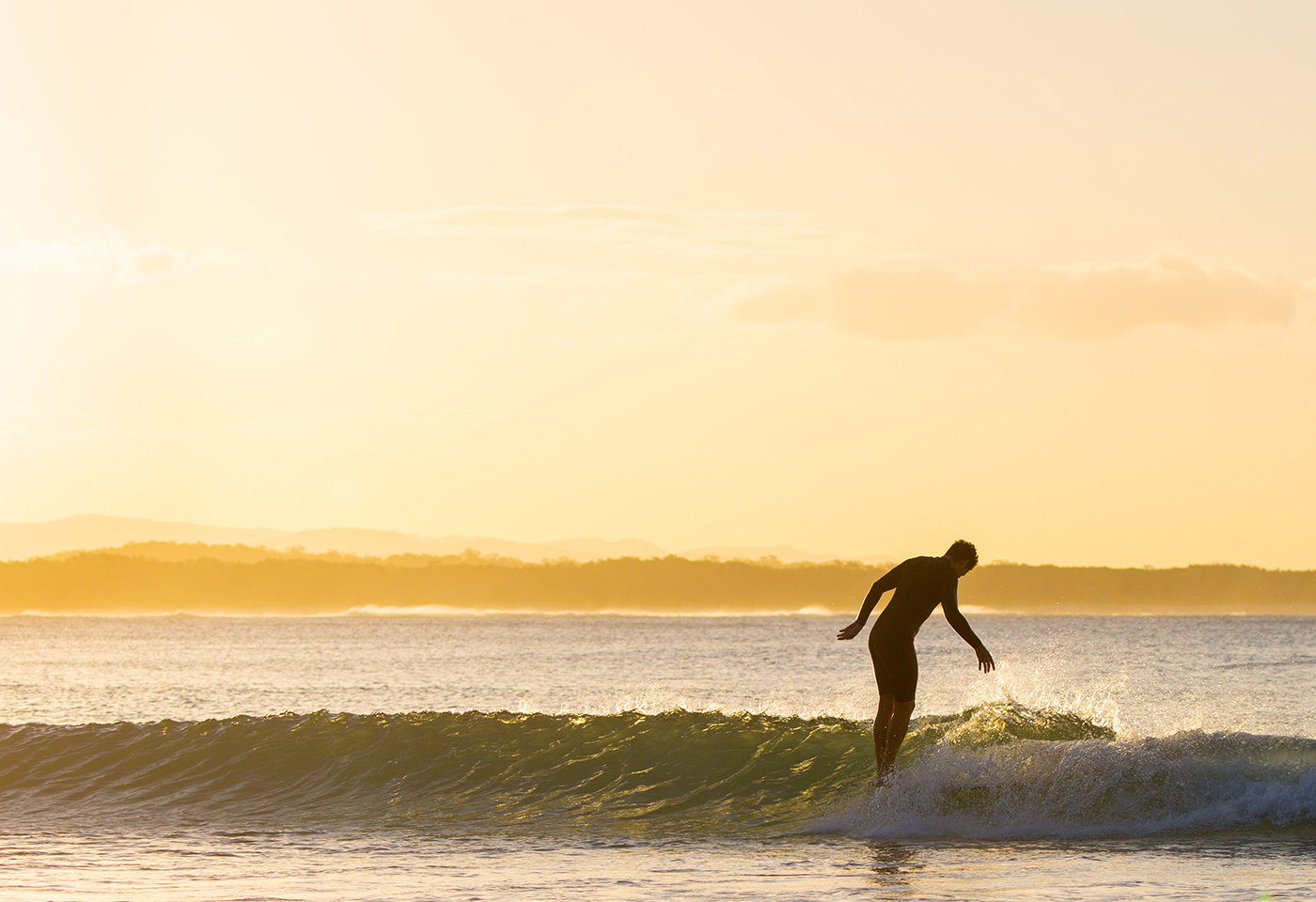Landscape image of surfer a sunrise by @miasara